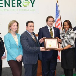 Hanley Energy LLC co-founders Dennis Nordon, VP and Clive Gilmore, President are presented with a prestigious certificate by invited dignitaries and the board of supervisors of Loudoun County Virginia.